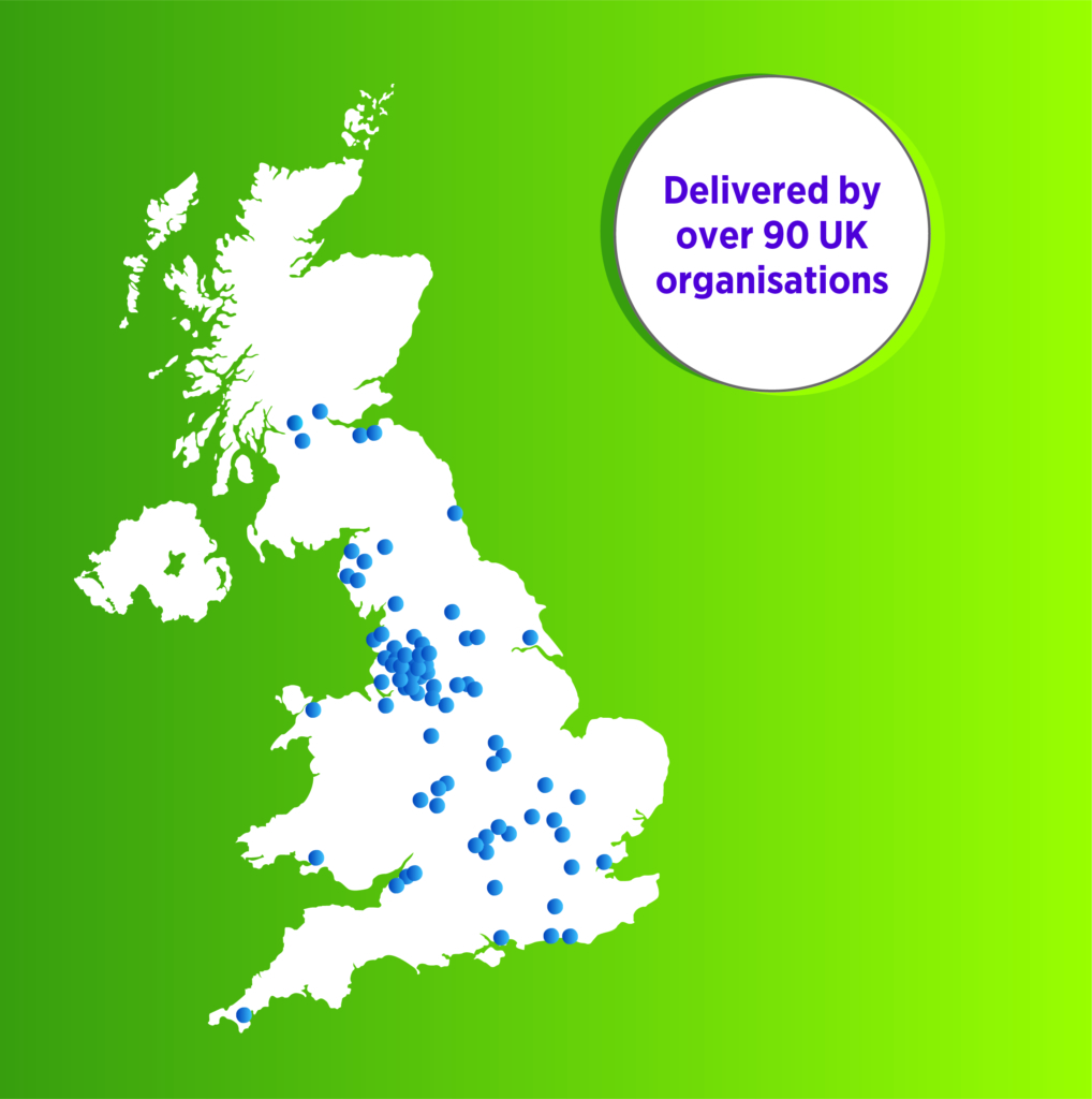 """An infographic showing a white map of the UK over a green background. On the map are many blue dots indicating different locations across the country. Next to the map is a white circle with the text """"Delivered by over 90 UK organisations""""."""